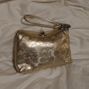 Gold Coach Coin Bag